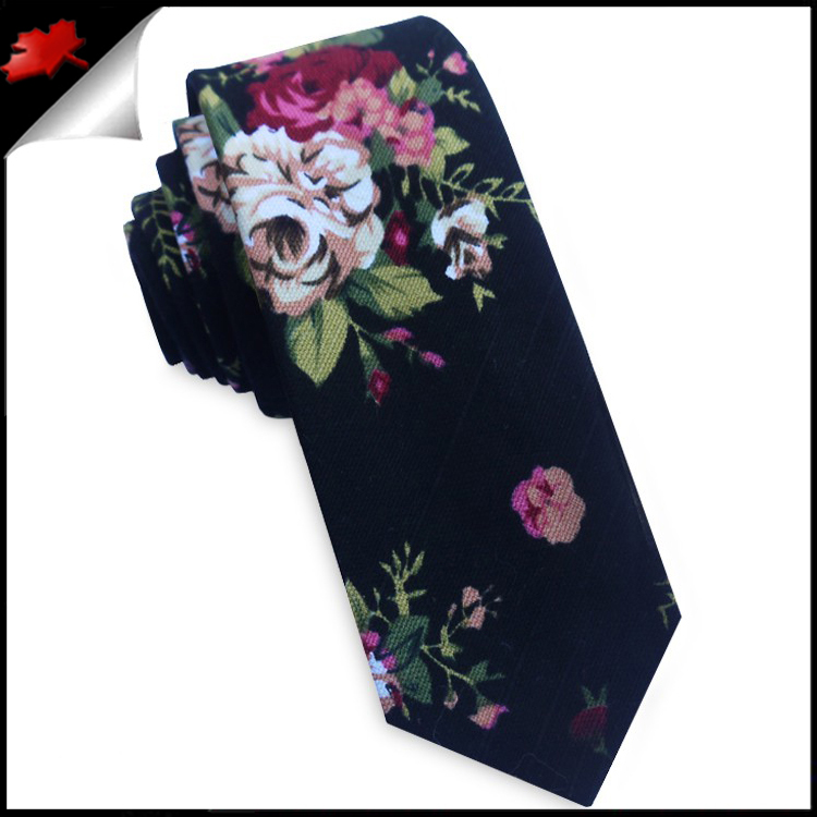 80e32c853918 A talking point tie that is sure to get heads turning, a lovely matte black  cotton blend tie with a bright floral pattern. Please note this tie has a  ...